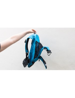 The space between the two main sections of the bag can be used to stash items such as jackets