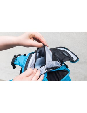 Refreshingly, the outer pouch features useable sized pockets inside