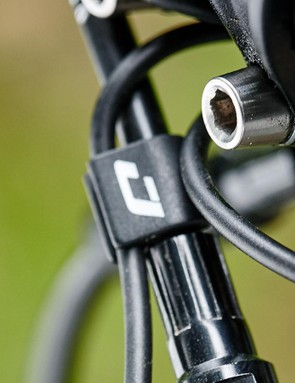 Brake and gear cables are clipped up neatly ready to be routed internally