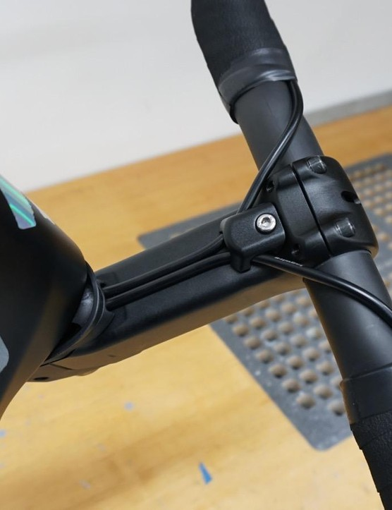 Hydraulic hoses and the Di2 wire run under the stem, which means you can change the bars and or stem without disconnecting the hoses