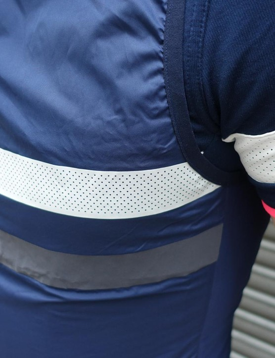 The jersey and gilet have reflective strips around the chest and arm