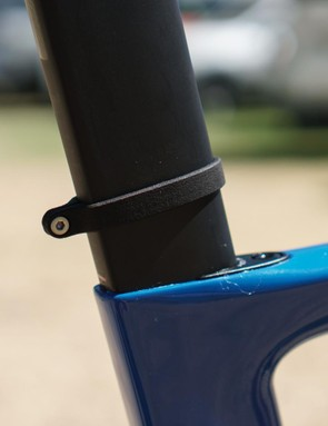 A 3D-printed number holder hugs the unique aero profile of the Venge's seatpost