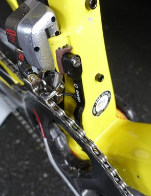 To keep the front derailleur from slipping, Direct Energie mechanics put a small piece of emory cloth between the chain catcher and the frame's hanger