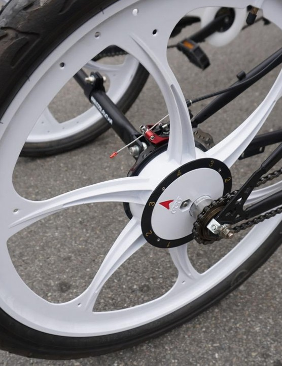 The hubs are offset on each of the wheels, making it bounce up and down as it rolls