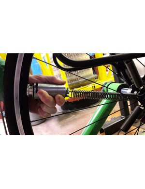 At a given speed, the weights move far enough along the spokes to be held in place by magnets