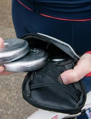Kilo weights are loaded into the bike's saddlebag