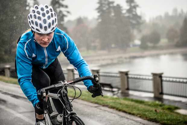 Woman works out on her bicycle in the rain