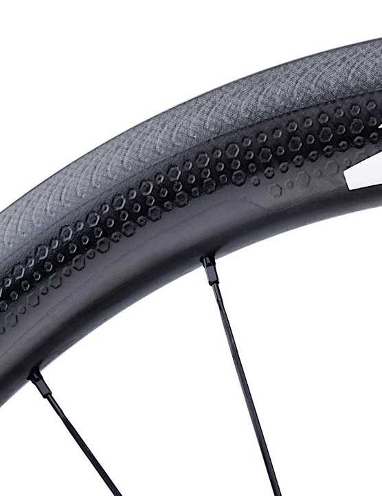 The 303 Firecrest tubular rim brake wheels get the etched Showstopper brake track
