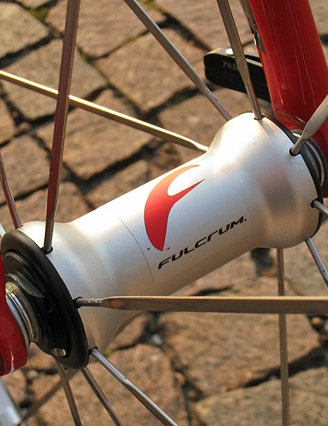 Radially-laced straight-pull bladed stainless steel spokes are used up front