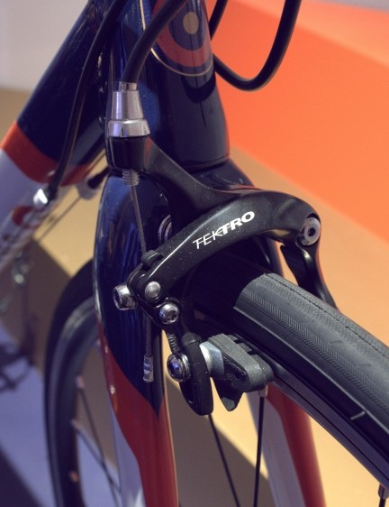 Tektro rim brakes and carbon forks feature on the top of the range Wiggins Rouen junior road bike