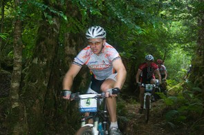 Riders descend through a meadow