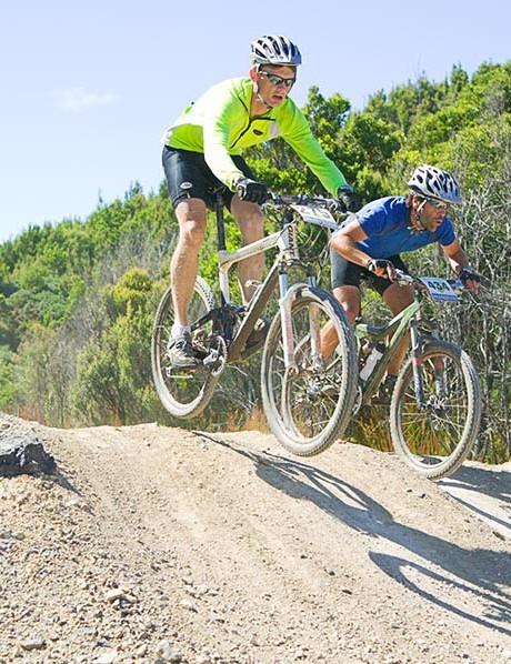 Jason McAvoy from Canberra literally jumps Tasmanian Gavin Wakefield.