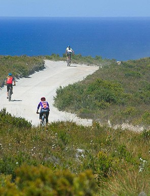 Riders roll contentedly towards the wild coast of Trial Harbour.