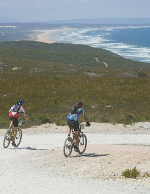 Riders take in the spectacular view of Ocean Beach .