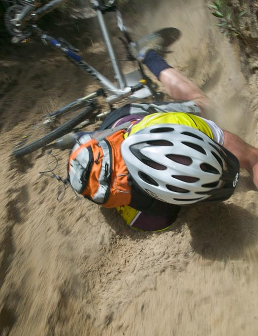 A rider goes over the bars but finds a soft sand landing…. Luckier than some!