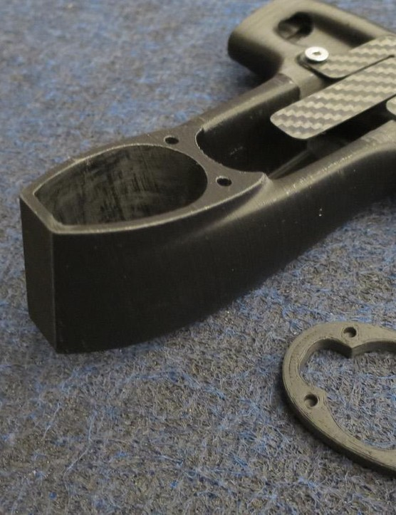 A 3D-printed prototype of the one-piece Alabarda cockpit's central section – the carbon spring piece bolted to the underside is a retaining clip for a Di2 control box
