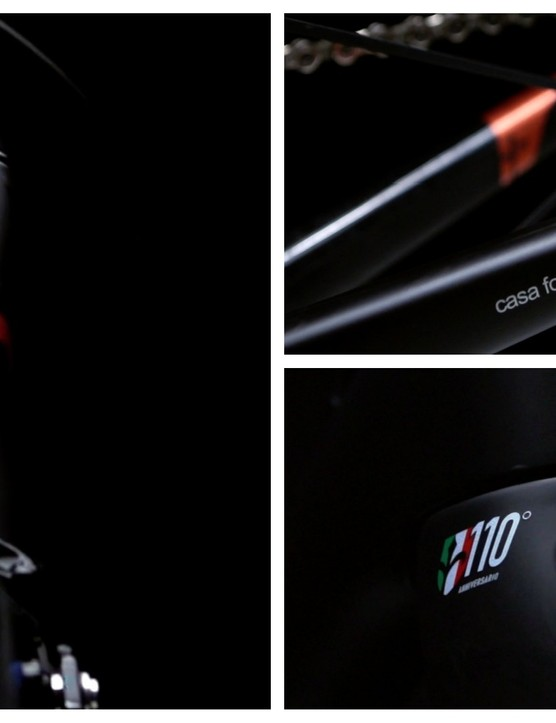 The carbon frame is matt black with gloss decals and copper highlights