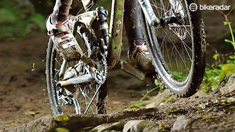 Lifting the front wheel clear of a root just needs a small wheelie or manual. Get the wheel back down to steer and shift the weight forwards again