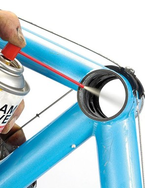 First, remove the cranks, bottom bracket and wheels. Get a can of Frame Saver, and spray it inside the frame