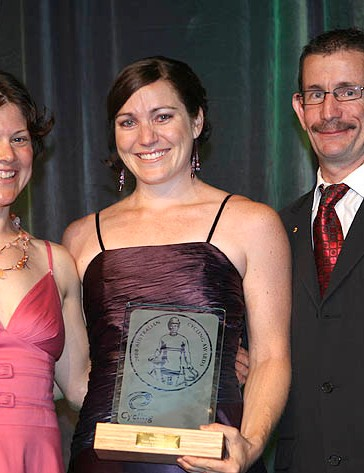 Retired cyclist Anna Wilson (left) and Paralympian Chris Scott (right) presented Anna Meares (centre) with the trophy for top track cyclist.