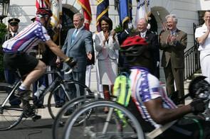 President Bush and Secretary of State Condoleeza Rice applaud the riders on their way