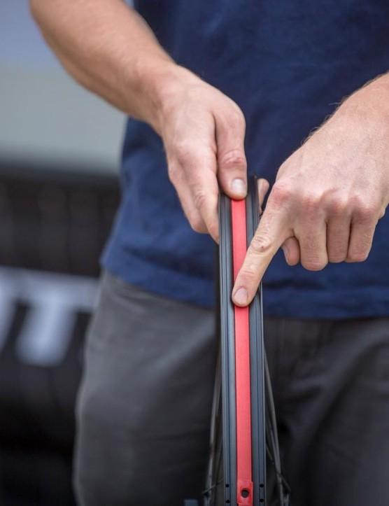 WTB has worked hard to improve its Tubeless Compatible System (TCS) and the TCS 2.0 is the result of that. Here, WTB's Clayton Wangbichler shows the new Solid Strip being installed