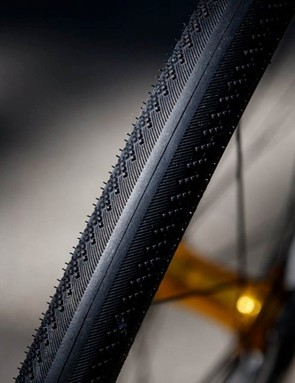 The tread pattern sees a smooth center channel and more aggressive shoulders