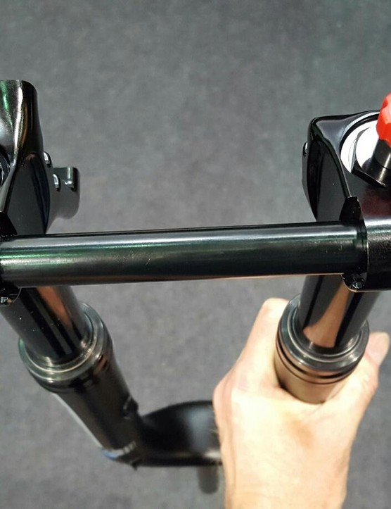 The fork appears to use X-Fusion's existing X-Lock 15mm thru-axle system