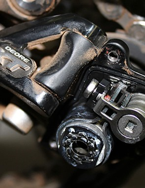 Shimano XT and SLX Shadow Plus rear derialleurs have a non-removable brace that reinforces the cam mechanism