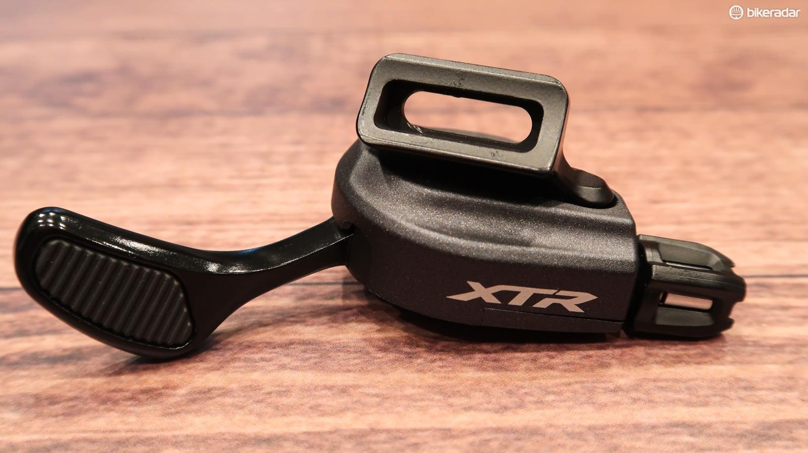 While it looks like a dropper lever, this is actually the very minimalist shifter for the front derailleur