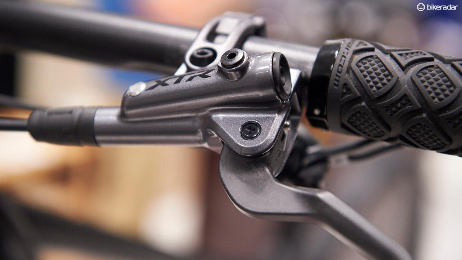 Shimano's XTR XC brake levers shave grams with carbon levers, while the Enduro version sticks with alloy