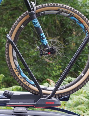 The bike is held securely by the front wheel hoops. As a result, front mudguards are not an option