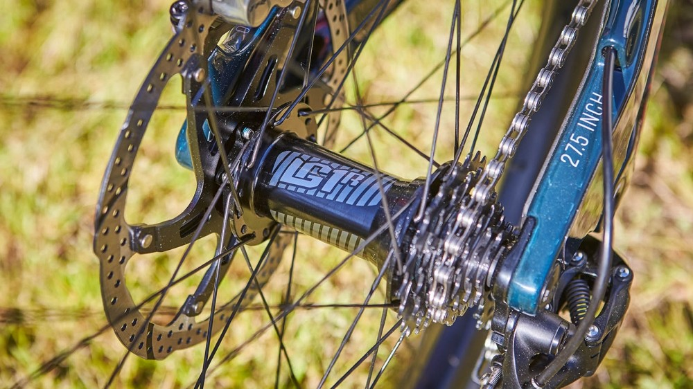 A compact 7-speed e*thirteen cassette provides a wide enough range for heading downhill