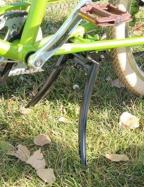 A moto-style kickstand stabilizes the bike when not being ridden