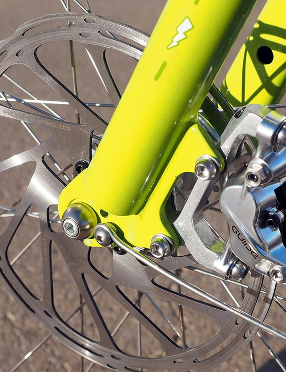 The SRAM Guide RSC hydraulic disc brakes are mounted to custom polished adapters