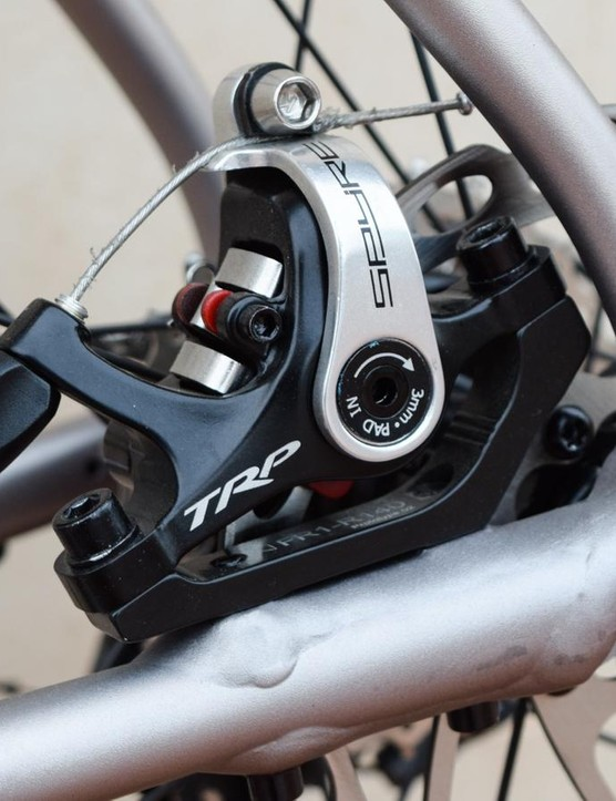 The rear brake caliper is tucked under the curved seatstay