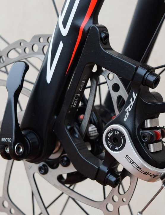A flat mount standard frameset means big adapters for these post-mount brakes
