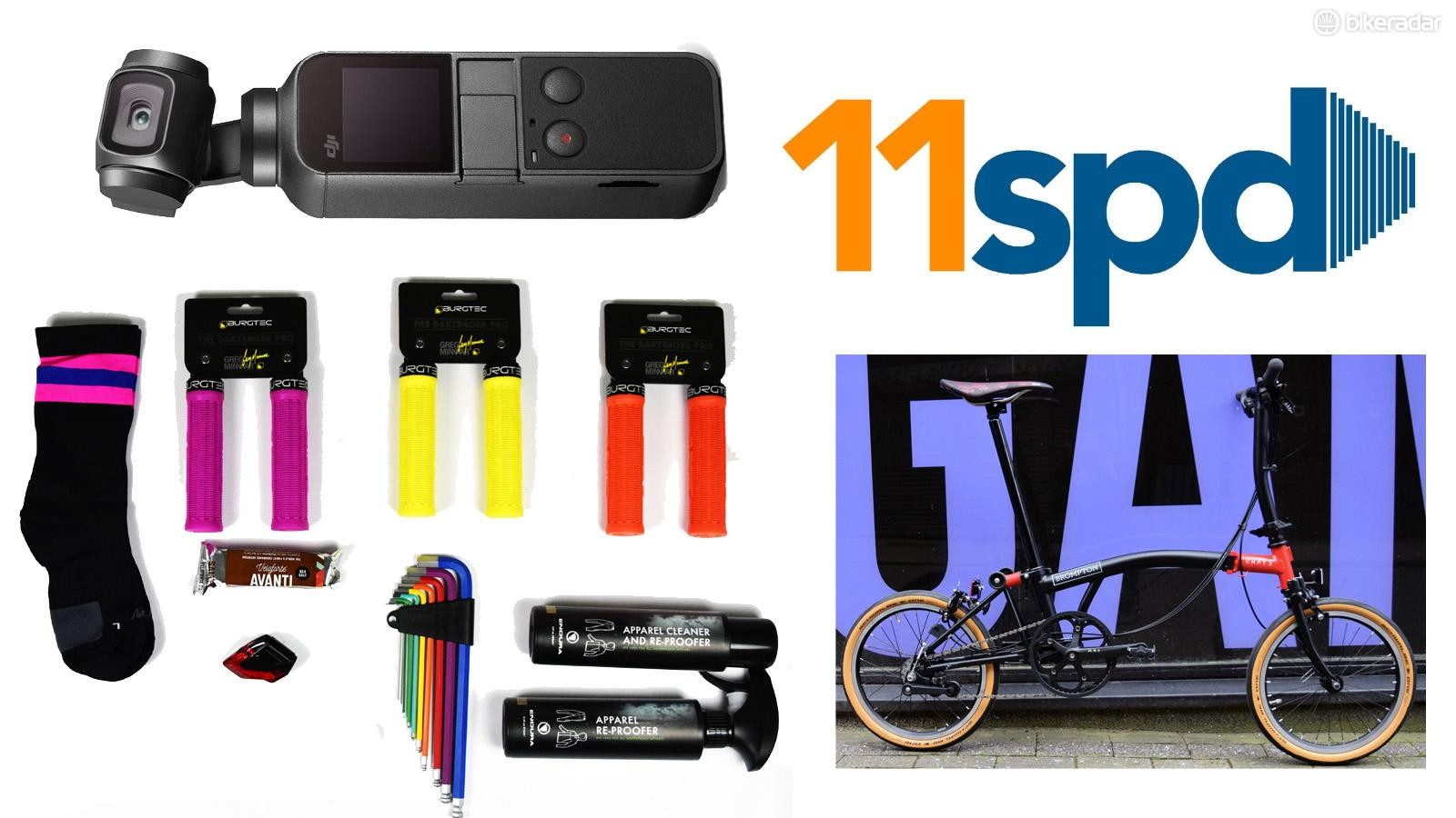 Flat lay of new bike products on a white background with the blue and yellow '11 spd' logo in the top right corner