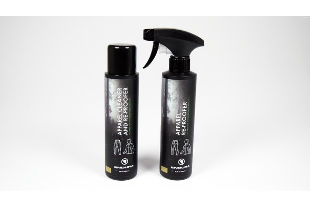 A black bottle and black spray bottle standing up against a white background. The bottles are by Endura.
