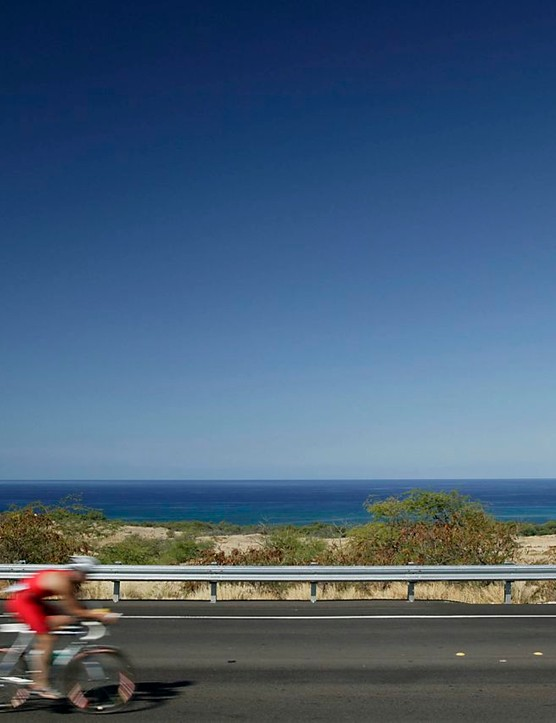 An athlete zooms down the Queen K highway at Ironman Hawaii