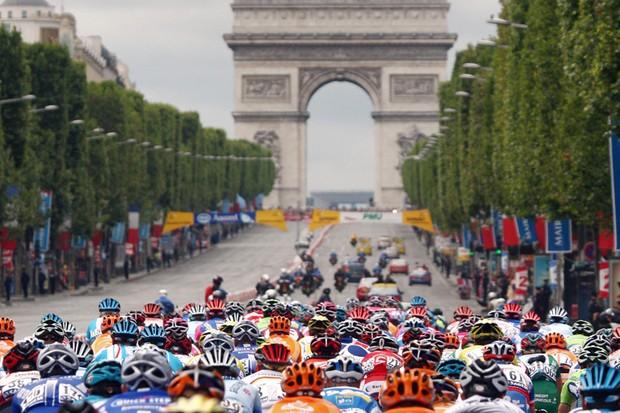 The Tour peloton rumbles down the Champs Elysees