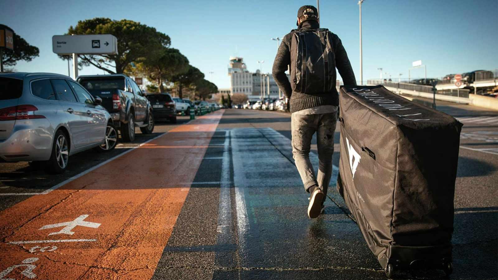 Man running along path at airport pulling the YT Body Bag
