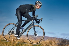 Male cyclist riding black bike in countryside