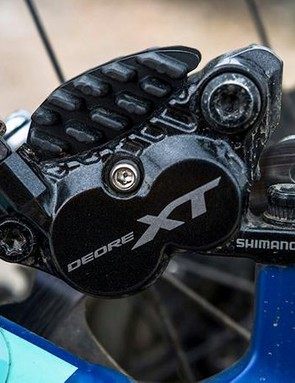 The four-pot Shimano XT brakes proved reliable on test