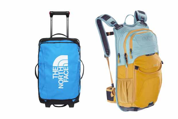 A blue wheeled suitcase and a light blue and orange rucksack on a white background