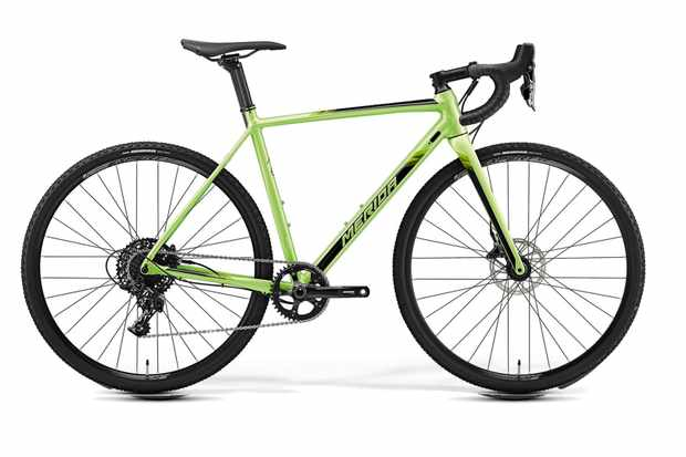 Green cyclocross bike by Merida on a white background