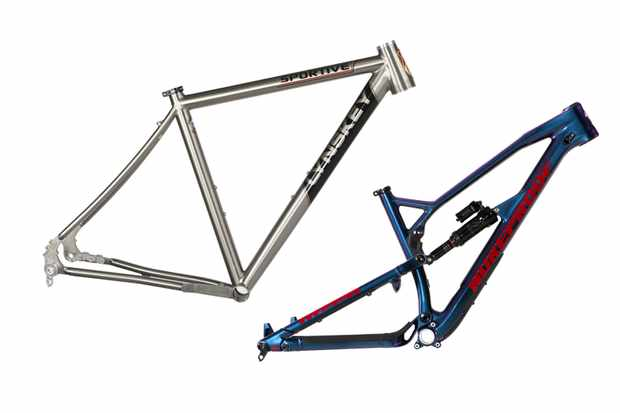 Photograph of a silver road bike frame and blue and red mountain bike frame on a white background