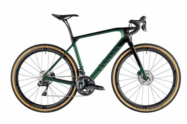 A photograph of a green and black gravel bicycle on a white background