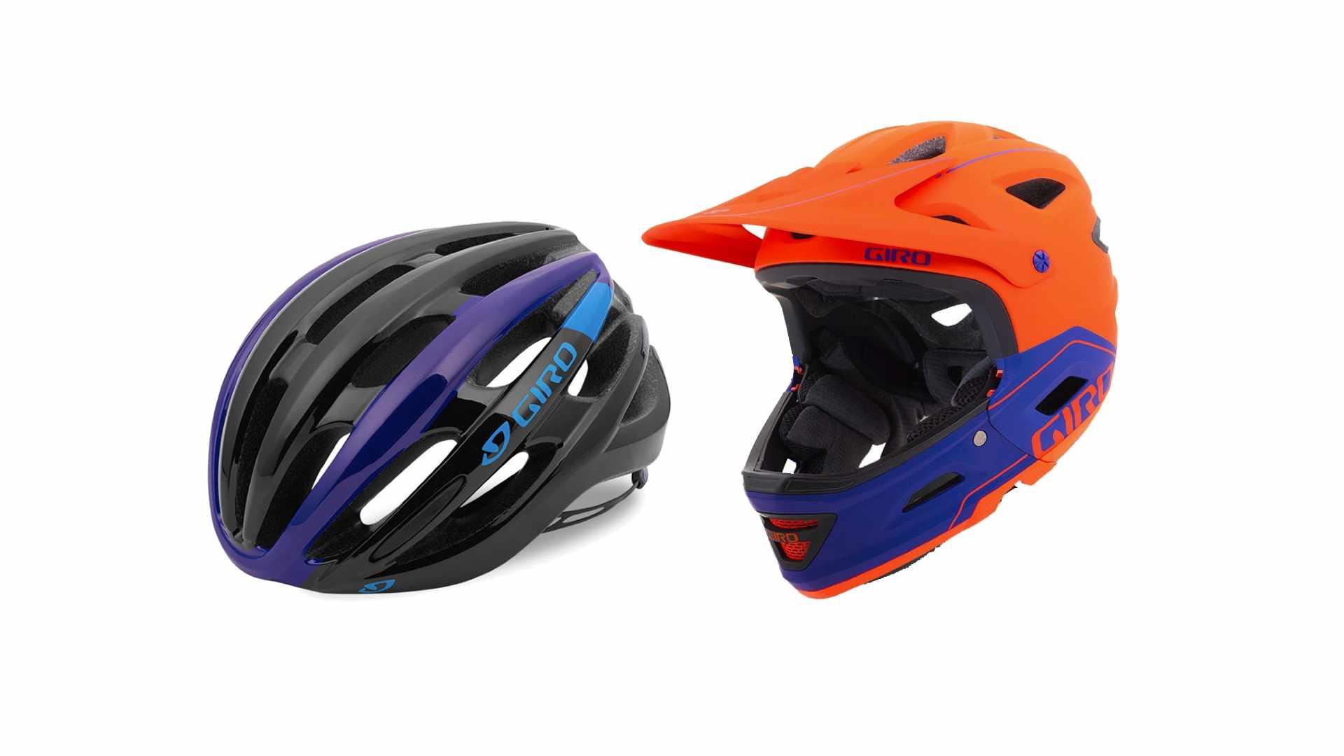 Two bike helmets on a white background