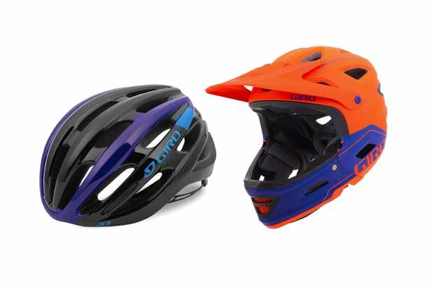 Two bike helmets on a white background